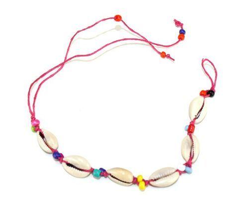 Bracelet artisanal en fil et caurie